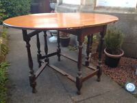 Old gate-leg drop-leaf dining table.