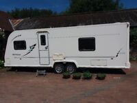 2010 Bailey Olympus 624 twin axle fixed bed caravan with awning