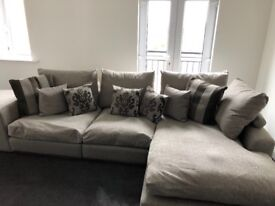 For sale beautiful corner suite, chair and puffet in grey fabric