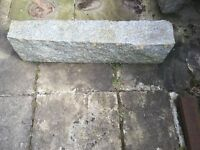 Five reclaimed granite kerbs.
