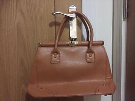 Tan handbag by Dune