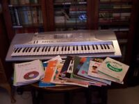 Casio CTK-800 Keyboard. Slightly used. With documents and 14 assorted song books etc.