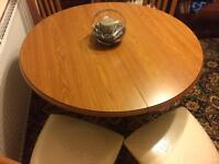 Round extending dining table + 4 chairs