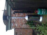 Infrared patio heater including protective cover and half a gas bottle