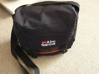 "ABU Garcia fishing bag approximately 10"" x 6"" x 8"" with two front and one side pocket. VGC. £7"