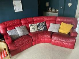 Red leather three seater corner sofa.
