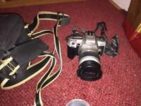 Minolta 35mm film SLR camera and camera bag and 2 filters (non digital)