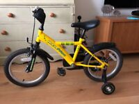 Kids first bike with stabilisers.