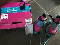Girls pink roller skates junior size 1 - great condition