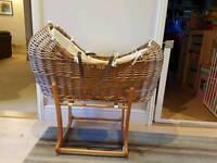 Moses basket with green sheep matress and protector