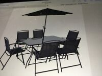 10 piece black patio set with 6 chairs table parasol and 2 x sun loungers £155 ono lot