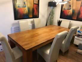 Solid oak dining table and 6 chairs...SOLD