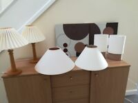 Bedside tables with matching wall art and additional pair of lamps and shades