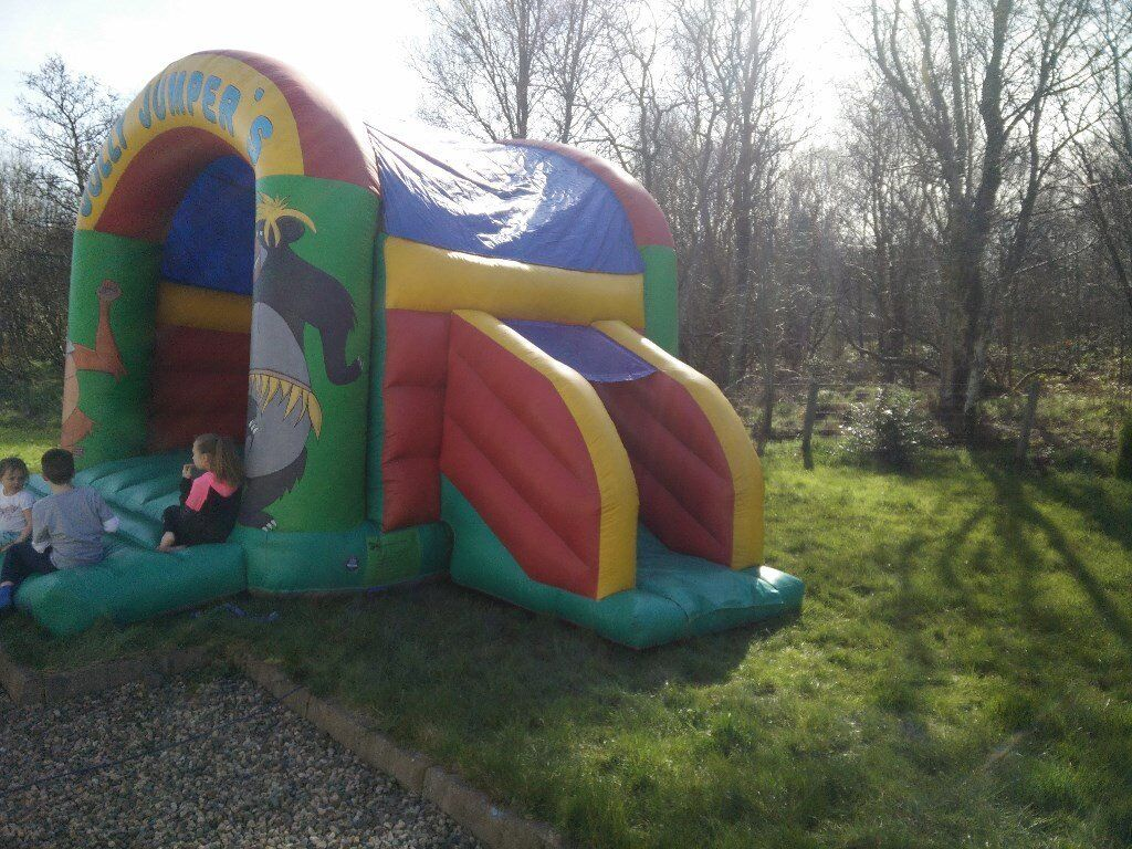 Large bouncy castle with roof and slide
