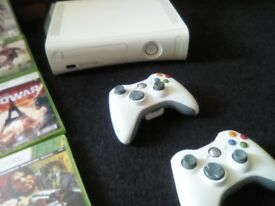 Xbox360+2 wireless controllers+24 games+ extra games on upgraded harddrive