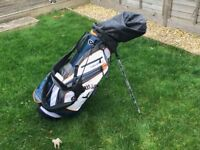 A set of Right Handed Wilson Golf Clubs in a Callaway Golf Bag