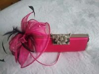 Matching fascinator and clutch bag in bright pink