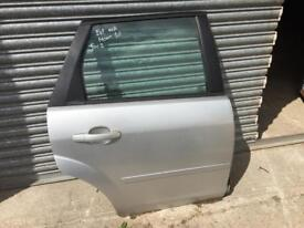 Ford Focus mk2 Estate drivers side rear door in moondust silver