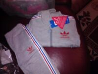 brand new with tags..adidas tracksuits...NOT FAKE..CLEARING STOCK