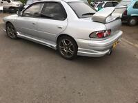 Subaru Impreza Turbo. Registered as gl