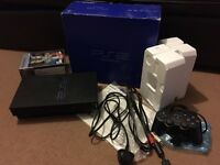 PS2 boxed with 4 games in very good condition
