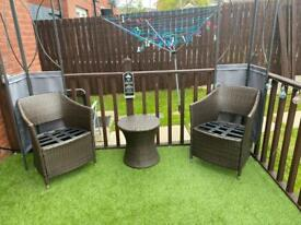 2 brown rattan garden chairs & matching table