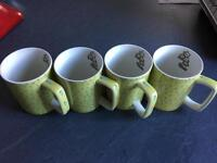 4 mugs bought from expensive gift shop . Katie Alice brand