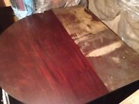 Hard wood table that needs some work.