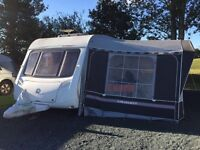 Swift charisma 540 caravan with remote motor mover and Isabella awning and fiamma awning