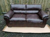 2 seater brown leather sofa ex display.