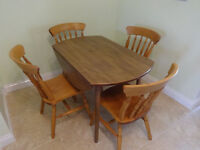 Lovely formica drop leaf round table and 4 solid wood chairs,vgc