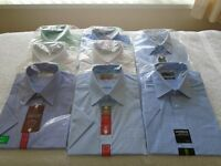 New and still in their packaging 8 short sleeved shirts size 16.
