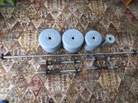 Two sets of dumbbells and barbell
