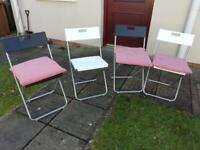 Set of 4 plastic foldable chairs