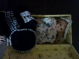 Small porcelain doll in box with 2nd outfit