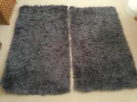Pair of grey bedside mats. Long pile, perfect