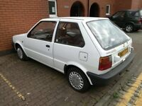 Much loved Nissan micra nearly a classic car. Needs work as photos show. Selling as no room.