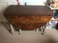 Dark grey wooden drop-leaf dining table