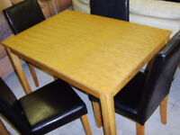 Square wooden table and four leather chairs