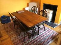 Dark solid wood table and 4 chairs