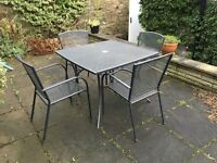 Grey metal outdoor garden table and chairs