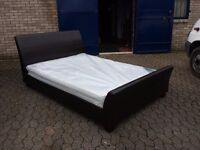 brown leather double sleigh bed with 10 inch thick mattress
