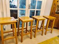 Four solid hardwood kitchen stools from John Lewis