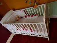 White wood cot and accessories