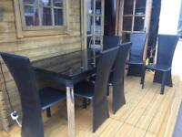 Dining room extendable table and 6 chairs black glass