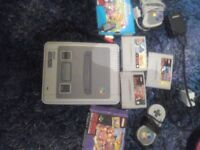 Retro super nintendo with pads and games..