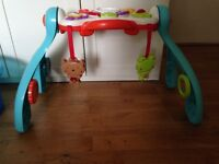 Baby play Centre by vtech and Early Learning Centre Activity Triangle Toy Activity.