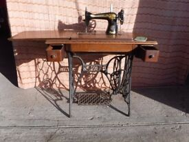 singer sowing machine vintage treadle. cast iron with manual,