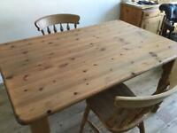 Pine dining table, two chairs.
