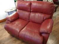 2 x 2 SEAT RED LEATHER SOFAS + footstool ONE RECLINES, GOOD CONDITION